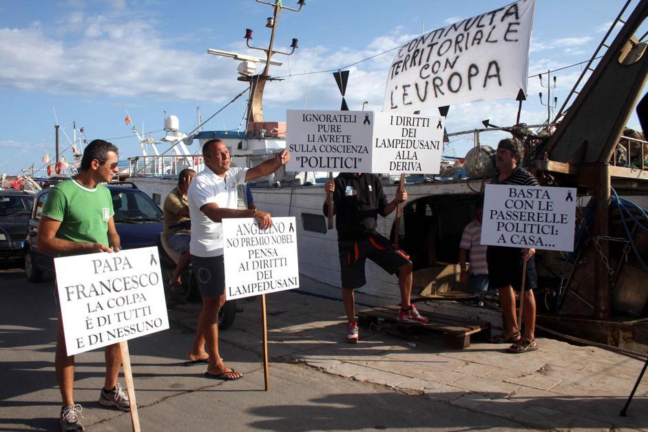 Баррозу на Лампедузе встретили словами «Убийцы!»
