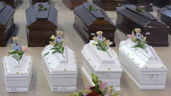 Coffin of victims are seen in an hangar of Lampedusa airport