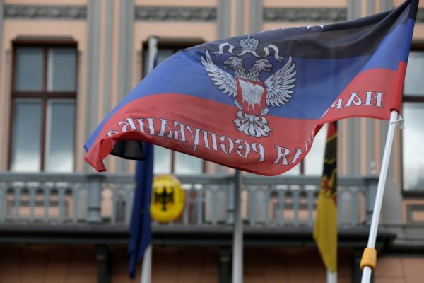 A protester waves a self-declared Donetsk People's Republic flag in front of Germany's embassy in Riga