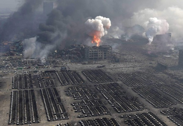 13 Aug 2015, Tianjin, Tianjin Municipality, China --- (150813) -- TIANJIN, Aug. 13, 2015 (Xinhua) -- Photo taken from a high place on Aug. 13, 2015 shows the site of huge explosions in Binhai New Area in Tianjin, north China. The blast, which occurred at a warehouse in the north China port city on Wednesday night, has killed 17 people and injured more than 400 as of Thursday morning, according to rescuers. (Xinhua/Yue Yuewei) (lfj) --- Image by © Yue Yuewei/Xinhua Press/Corbis