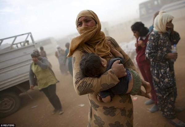 1411589342761_wps_6_A_Kurdish_Syrian_refugee_