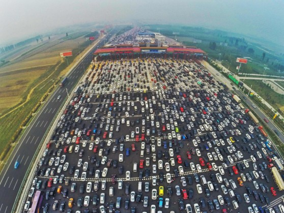 BEIJING, CHINA - OCTOBER 06: (CHINA OUT) .Travel Peak Appears On Beijing-Hong Kong-Macau Expressway At End Of Chinas National Day Holiday..Aerial view of cars queuing up to pass a checkpoint set recently in the direction of Beijing on the Beijing-Hong Kong-Macau Expressway at the end of National Day Holiday on October 6, 2015 in Beijing, China. A travel peak appeared at the end of 7-day China's National Day Holiday. .©Whitehotpix (Credit Image: © Whitehotpix via ZUMA Press)