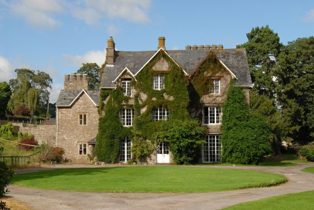 Pictured: An original exterior view of Llanwenarth House Wealthy property developer Kim Davies, who illegally modernised the historic building behind a famous hymn has been declared bankrupt. Kim Davies has made unlawful changes to Llanwenarth House - the Grade II listed building where All Things Bright And Beautiful was penned by Irish composer Cecil Alexander. He was found guilty by Newport Crown Court last year.