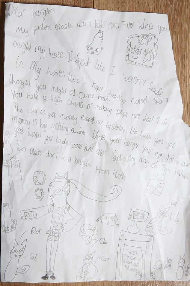 PIC BY MIKE JONES/ CATERS NEWS - (PICTURED: Holly's letter) - A schoolgirl who had jewellery stolen by burglars wrote to the thieves and told them to GET A JOB. Holly Crabtree, six, penned the open letter after the culprits broke into her home and ransacked the bedrooms while the family were out on a shopping trip. But the family first realised they had been robbed after they found their cat, Lily, inside the house despite putting it out before going shopping. SEE CATERS COPY.