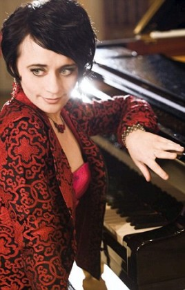 Picture of Natalie from her website. Musician John Martin has been named locally as the man being questioned on suspicion of murder after his partner Natalia Strelchenko, who was also known as Natalia Strelle, the international concert pianist she was found at their home in Manchester with multiple head injuries and died a short time later. Natalia was discovered in the early hours of Sunday after reports from neighbours that a woman had been assaulted. At around 12.45am on Sunday 30 August 2015, police and paramedics were called to an address on Culcheth Lane, Newton Heath, to reports that a woman had been assaulted. Officers attended the address and discovered 38-year-old Natalia Strelle with serious head injuries. Paramedics attempted to revive Natalia at the scene, but she sadly died a short time later. A Home Office post-mortem examination has been carried out and found that Natalia died from head and neck injuries. A 48-year-old man who was arrested yesterday on suspicion of murder remains in police custody for questioning.