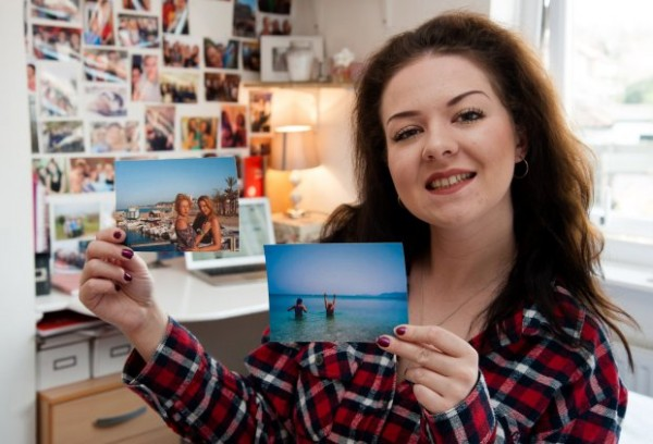 PIC BY KEITH WHITMORE/ CATERS NEWS - (PICTURED: Laura Rose holding pictures of her and her friends on holiday she funded using money she made on Ebay) - This is the savvy student who splashes the cash on jetset holidays - after making a whopping 30,0000 selling her old clothes on ebay. While her friends scrimp and save their way through university, Laura Rose splashes out on THREE holidays a year thanks to her eBay earnings. The pretty third-year student, who is studying business management at the University of East Anglia, started flogging her old clothes when she was still in sixth form. But she soon became hooked and found she could make a hefty profit getting rid of her unwanted garments. SEE CATERS COPY.