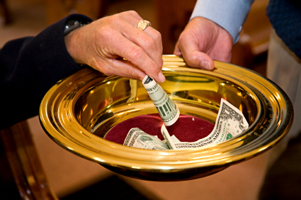 Photo of a collection plate in a church.