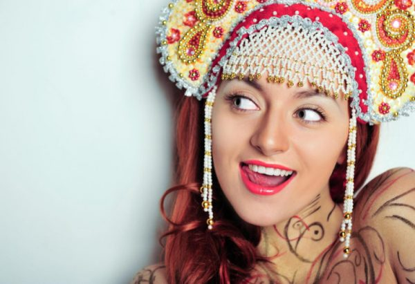 Closeup portrait of young beautiful woman wearing russian traditional hat kokoshnik. Advertisement banner for beauty and fashion industry with copyspace