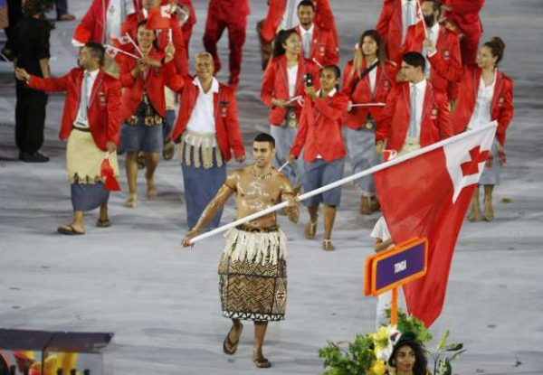 2016 Rio Olympics - Opening ceremony - Maracana - Rio de Janeiro, Brazil - 05/08/2016. Flagbearer Pita Nikolas Taufatofua (TGA) of Tonga leads his contingent during the athletes' parade at the opening ceremony. REUTERS/Stoyan Nenov TPX IMAGES OF THE DAY FOR EDITORIAL USE ONLY. NOT FOR SALE FOR MARKETING OR ADVERTISING CAMPAIGNS.