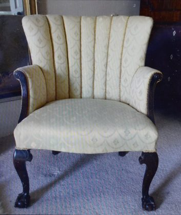 The newly upholstered chair bought for £5 in which Angus Milner-Brown found hidden jewellery in. A couple who bought a dusty old chair for just £5 were astonished to discover diamond jewellery worth £5,000 hidden inside it. See CENTRE PRESS story CPBLING. Angela Milner-Brown, 50, and her husband Angus, 47, had no idea what was hidden inside the chair until years after they bought it. The couple, from Biggar, South Lanarkshire, snapped the chair up at an auction around 10 years ago for just £5 - but could not afford to have it reupholstered. Instead, they kept it in their attic for six years, utterly unaware of the valuable secrets that were hidden inside. Angela, a scientific proofreader, said: ìWe bought the chair at an auction for £5 but that was years ago now.