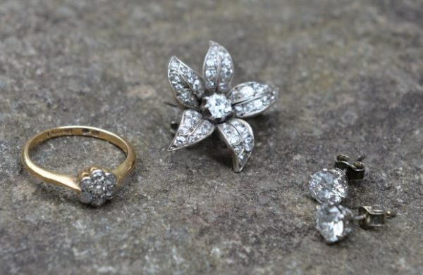 The find included a flower broche from 1890, earrings from 1900 and a ring from 1900. A couple who bought a dusty old chair for just £5 were astonished to discover diamond jewellery worth £5,000 hidden inside it. See CENTRE PRESS story CPBLING. Angela Milner-Brown, 50, and her husband Angus, 47, had no idea what was hidden inside the chair until years after they bought it. The couple, from Biggar, South Lanarkshire, snapped the chair up at an auction around 10 years ago for just £5 - but could not afford to have it reupholstered. Instead, they kept it in their attic for six years, utterly unaware of the valuable secrets that were hidden inside. Angela, a scientific proofreader, said: ìWe bought the chair at an auction for £5 but that was years ago now.