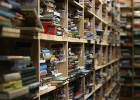 HALLATROW, UNITED KINGDOM - DECEMBER 12: Second hand books are stacked on shelves at the Bookbarn International in one of their warehouses on December 12, 2008 near Hallatrow in Somerset, England. Currently selling up to several thousand books a day and mostly online via Web sites such as Amazon.com, Bookbarn International is the UK's largest second hand book warehouse with over 5 million titles stored in two giant barns in a field in Somerset. Helped in part by the credit crunch, sales of second hand books have risen sharply recently with the weak British pound only helping the Bookbarn to sell more books internationally. (Photo by Matt Cardy/Getty Images). (Photo by Matt Cardy/Getty Images)