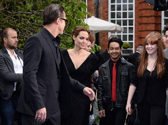 Брэд Питт, Анджелина Джоли и их сын Мэддокс с девушкой