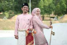 Со свадьбы на рампу. Пара малайзийских лонгбордистов посвятила свадебное торжество любимому увлечению