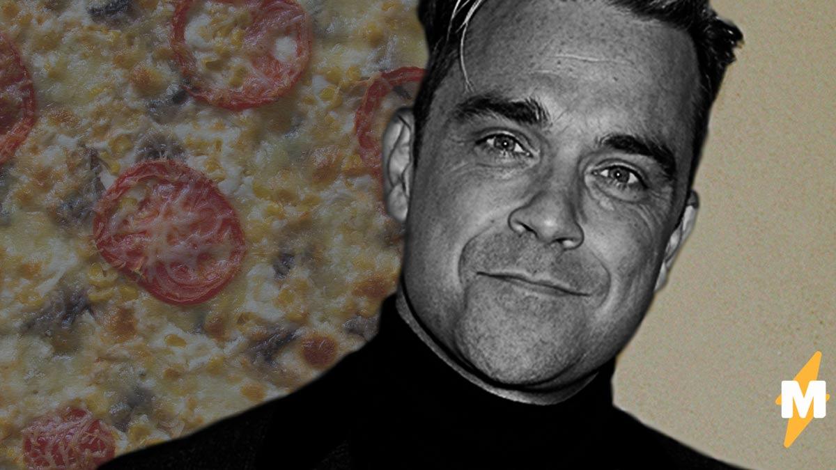 Робби Уильямс высказался в поддержку теории пиццагейт. Но люди не в восторге от любви певца к конспирологии