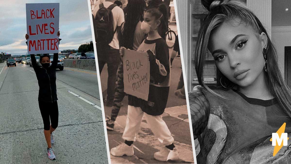 Фотографы ловят звёзд на участии в протестах, и для людей они теперь - герои. Зато Кайли Дженнер досталось
