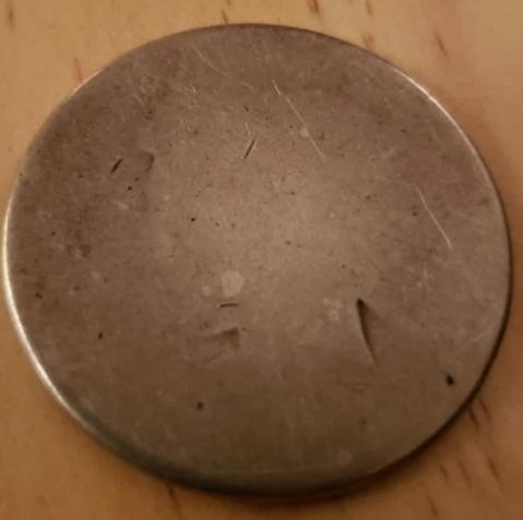 Дед проходил с монетой в кармане 50 лет и теперь её не узнать. Кажется, нужно постараться, чтобы её потратить