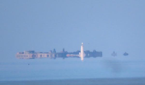 Фотограф поверил в существование воздушных замков, увидев один в небе. Ему повезло - он успел заснять здание