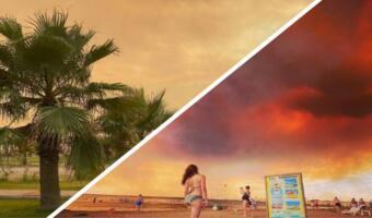 Русскоязычные туристы делают фото на фоне клубов дыма в Анталье, где горят леса