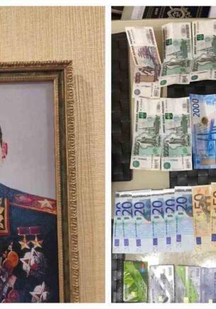 Дома у чиновника из Ростова нашли его портрет со звёздами героя СССР и пачки денег