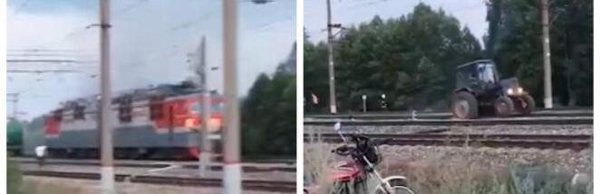 Трактор на видео оттащил горящий тягач поезда от цистерн с топливом